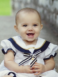Baby with blue and white dress